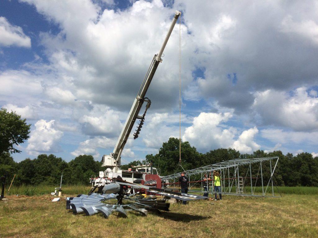 Crane Installing New Windmill
